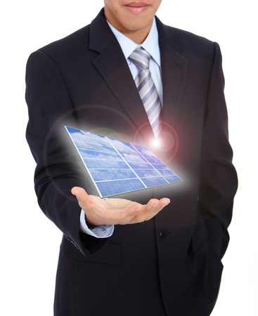 electric cell: young business man holding a solar panel and power