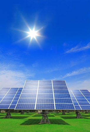 solar collector: Solar Panel with green grass and beautiful blue sky Stock Photo