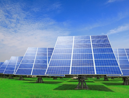 photovoltaic power station: Solar Panel with green grass and beautiful blue sky Stock Photo