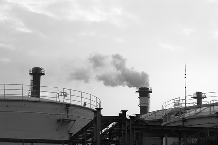 Pollution smoke from factory,  Contrast concept of global warming in b&w.