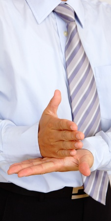 Stop hand gesture by business man photo