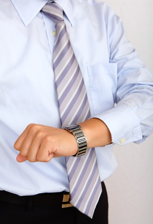 working hour: time is up, business man hand finger and watch Stock Photo