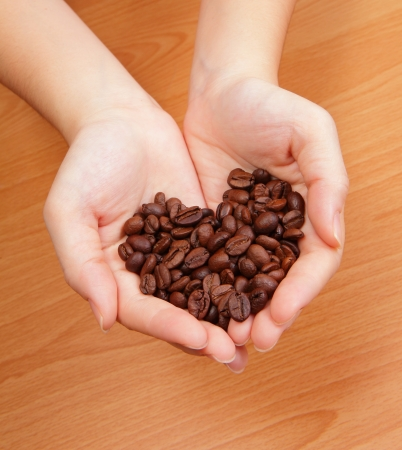 christmas ground: Coffee bean in the hand and coffee bean is love heart shape