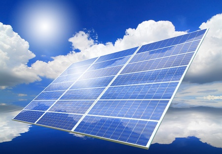 Solar Panel with reflection of blue sky ,white cloud and sun photo