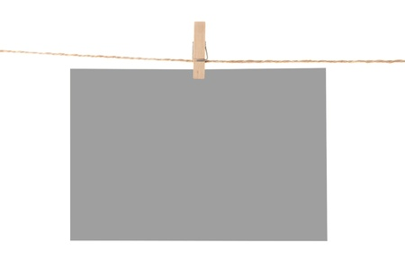 Photo paper attach to rope with clothes pins isolated on white background photo