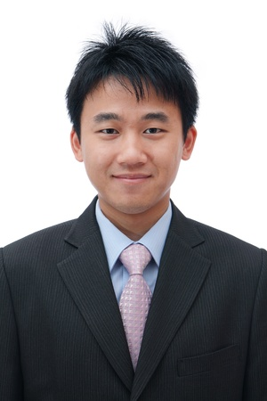 Face of asian business man with friendly smile photo