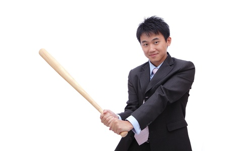 Business man holding baseball bat with friendly smile, it's time for homerun photo