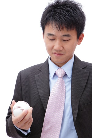 young adult man: Asian Business man watch ball in the hand