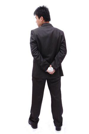 detras de: Boss (El hombre de negocios) que sostiene la bola en la espalda