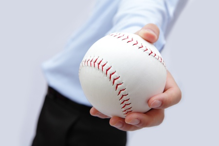 Business man hand holding a baseball Stock Photo - 11344232