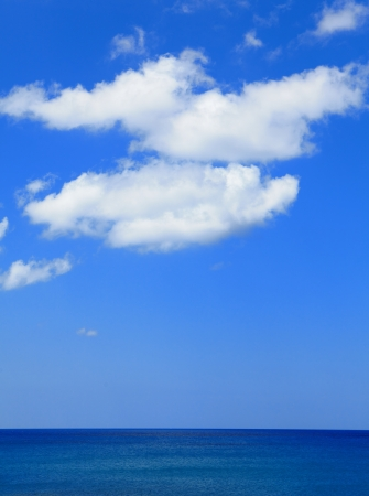 comfortable blue sea, sky and white cloud photo