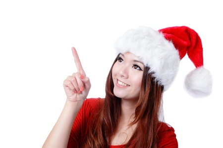 Young happy Christmas girl smile introduce by finger,  isolated on white background photo