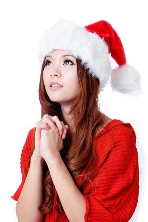 make a gift: Young Beauty Girl wish with christmas hat and red cloth
