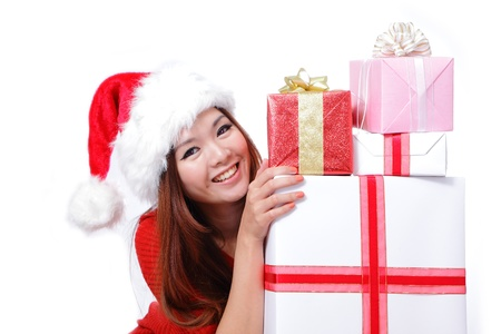 Young happy girl in Christmas hat smile holding huge christmas gift isolated on white background photo