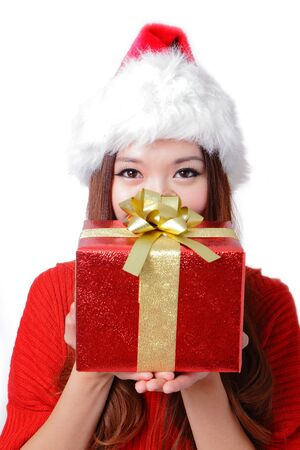 Young happy girl in Christmas hat holding huge christmas gift isolated on white background photo