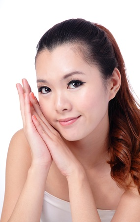 Asian beauty skin care Girl smiling close-up, Beautiful young woman touching her face looking to the side. Isolated on white background Stock Photo