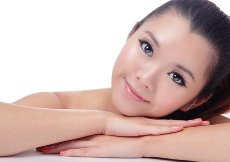 Asian beauty skin care Girl smiling close-up, Beautiful young woman touching her face looking to the side. Isolated on white background Stock Photo - 11561148