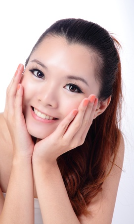 Asian beauty skin care Girl smiling close-up, Beautiful young woman touching her face looking to the side. Isolated on white background Stock Photo - 11561194