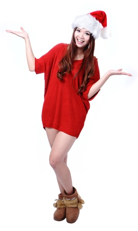 Christmas Happy Girl with red cloth and hat, Model is a cute asian beauty, isolated on white background photo