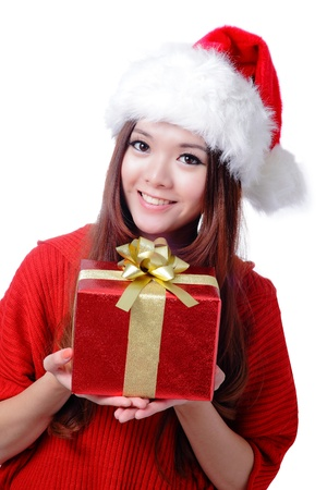 Christmas Girl Smile Holding Gift Box, Model is a cute Asian beauty,  isolated on white background Stock Photo - 11561163