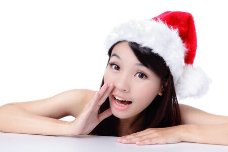 Young Christmas Girl talking to you isolated on white background, model is a asian beauty Stock Photo - 11561153