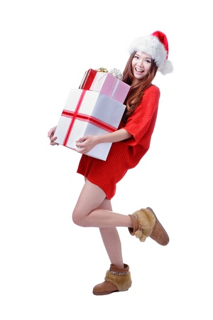Christmas happy Girl Smile Holding Gift Box, Model is a cute Asian beauty,  isolated on white background photo