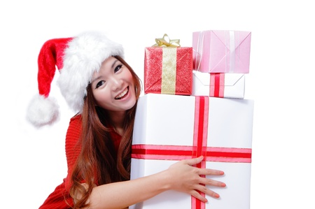Young happy girl in Christmas hat smile holding huge christmas gift isolated on white background, model is a asian beauty. photo