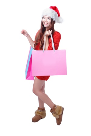 Beauty Christmas Girl Take Pink Blank Shopping Bag, Beautiful and cute Asian female model, isolated on white background Stock Photo - 11561164