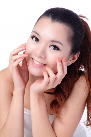 Asian beauty skin care woman smiling close-up, Beautiful young woman touching her face looking to the side. Isolated on white background Stock Photo - 11561172