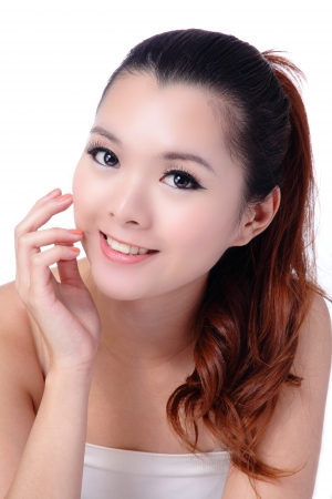 Asian beauty skin care woman smiling close-up, Beautiful young woman touching her face looking to the side. Isolated on white background photo