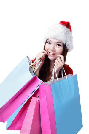 Beautiful Christmas woman happy take shopping bag isolated on white background photo