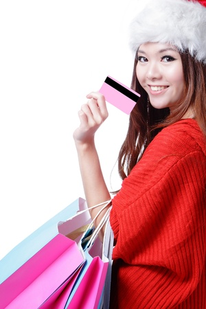 Beautiful Christmas woman happy take credit card and shopping bag isolated on white background photo