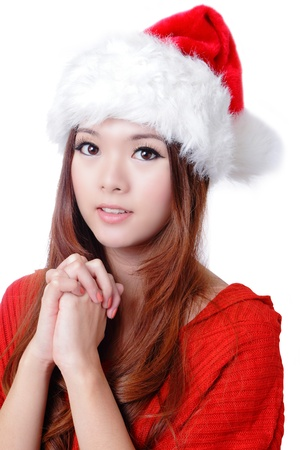 make a gift: christmas Beauty Girl wish with red hat and cloth Stock Photo