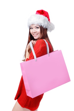 Beauty Christmas Girl Take Pink Blank Shopping Bag, Beautiful and cute Asian female model, isolated on white background photo