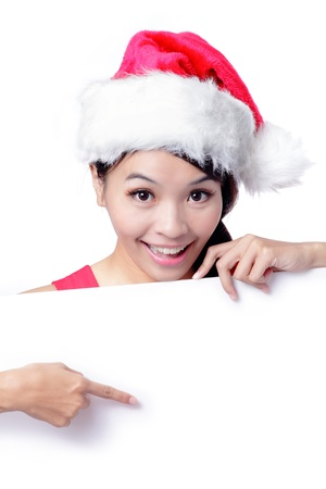 Beautiful Christmas Girl smile Show blank billboard isolated on white background, Model is a asian beauty photo
