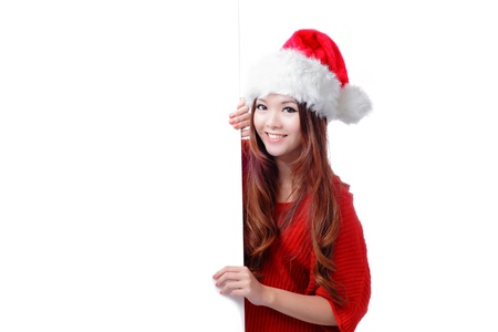 Christmas Happy beauty smile showing blank billboard isolated on white background, Model is a cute asian girl photo