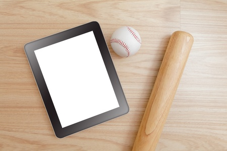 Baseball and tablet pc (blank touch panel monitor ) with wood background photo