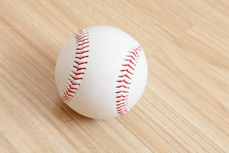 Baseball with wood background photo