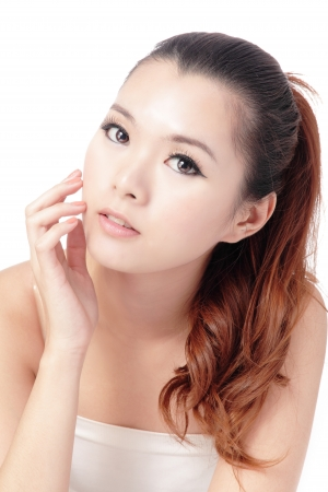 hand on face: Asian beauty skin care woman face, Beautiful young woman touching her face looking to the side. Isolated on white background Stock Photo