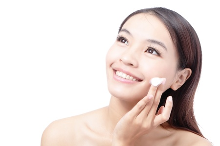 Beautiful woman washing her beauty face with cleansing foam on her hands for skin care concept , isolated on white background, model is a asian girl Stock Photo - 11720516