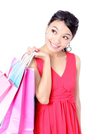Happy Shopping Girl Holding bag isolated on white background, Model is a asian beauty photo