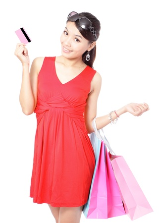 Shopping woman happy take credit card and shopping bag isolated on white background, model is a asian beauty Stock Photo - 11720508