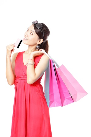 credit card purchase: Shopping woman happy take credit card and shopping bag isolated on white background, model is a asian beauty