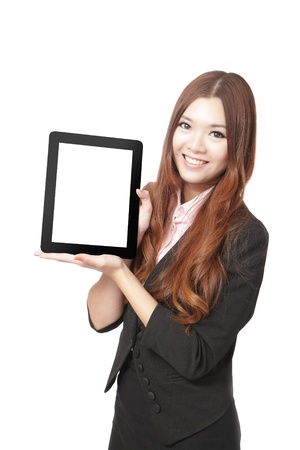 tablet pc in hand: Business woman smile and showing tablet pc isolated on white background, model is a asian beauty