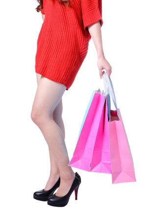 Sexy Legs of shopping lady showing shopping bag. Isolated on white background Stock Photo - 11720552