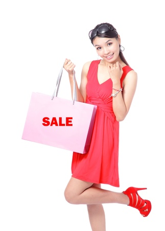 asian girl shopping: Happy Shopping Girl Holding bag isolated on white background, Model is a asian beauty