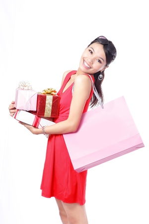 fancy bag: Shopping woman happy take big shopping bag and gift isolated on white background, model is a asian beauty Stock Photo
