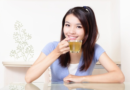 Beauty woman relax drink tea with home background, model is a asian beautiful girl photo