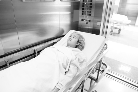 patient before surgery in elevator photo