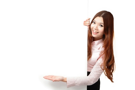 exhibiting: Young Business Woman Happy Smile Showing blank billboard isolated on white background, Model is a asian beauty Stock Photo